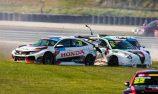 Wall Racing assessing damaged Martin Honda