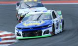 Elliott recovers from shunt to take victory in Charlotte